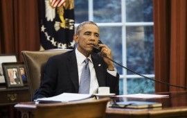 U.S. President Obama speaks on the phone with Saudi Arabia's King Abdullah from the Oval Office of the White House in Washington